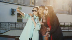 Hipster friends are doing selfie. Laugh, make funny faces Stock Footage