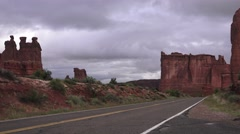 4x4 driving towards monuments, ARCHES NATIONAL PARK Stock Footage