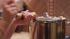 Close up of somebody making popcorn on the stove Stock Footage