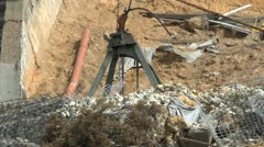 Crane Lifting Rubble From Cliffs Landslide Stock Footage