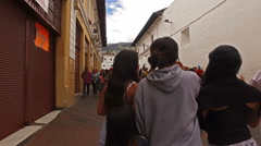 Walking down a crowded Street in Old Town Quito Stock Footage
