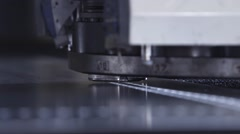 Machine pounding holes in sheet metal - stock footage