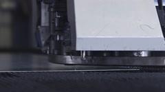 Machine pounding holes in sheet metal Stock Footage