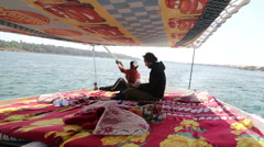 Man sailing with felucca on Nile river Stock Footage