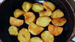 Fried potato on skillet Stock Footage