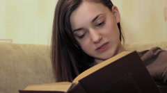 Girl reading a book Stock Footage