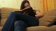 Girl reading book Stock Footage