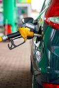 Car refueling on a petrol station Kuvituskuvat