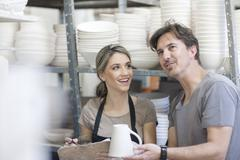 Potters chatting at crockery factory Stock Photos