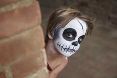 Boy with face painting of skull Stock Photos