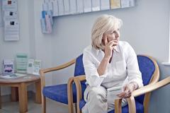 Mature female patient in hospital waiting room Kuvituskuvat