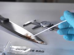 Forensic investigation of knife from crime scene Stock Photos