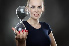 woman and sand timer - stock photo