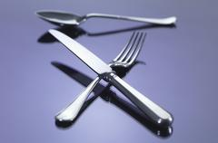 Knife, and fork in cross shape with spoon Stock Photos