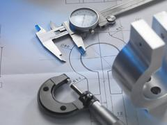 Engineering drawing with product, micrometer and calipers Stock Photos