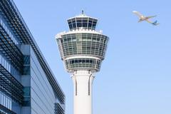 Munich international airport control tower and departing taking off plane Stock Photos