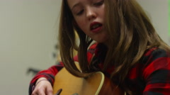 A girl taking guitar lessons, close up Stock Footage