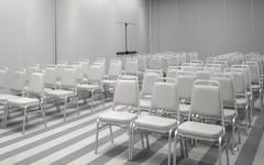 White chairs in empty auditorium - stock photo