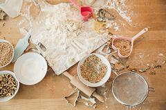 Ingredients, baking mold, bowls, rolling pin, sieve - stock photo
