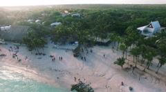 4K Aerial drone shot mexico akumal along beach boats palm trees Stock Footage