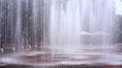 Large fountain in city park, water stream splashing around, summer, recreation Stock Footage