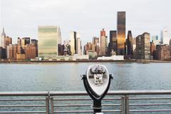 View of tourist binoculars toward East River and manhattan skyline, New York, - stock photo