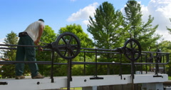 Man Cranking Wheel To Open Ottawa Locks Stock Footage