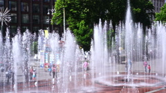 Large fountains at main city square, many people walking, enjoying summer day Stock Footage
