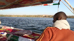 Nubian man and female tourist sailing with felucca on the Nile river Stock Footage
