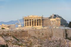 acropolis in rays of sunset - stock photo