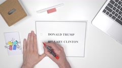 4K Hillary Clinton Voting on Paper - Top View Stock Footage