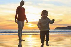 Mother and toddler son playing on beach, San Diego, California, USA Stock Photos