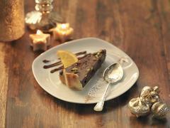 Pistachio and chocolate torte amongst festive decorations Stock Photos