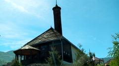 "Old, wooden ""Carsijska dzamija"" Islamic building in the Plav town - stock footage"