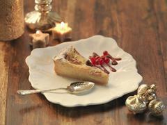 Fig and amaretto frangipane tart amid festive decorations Stock Photos