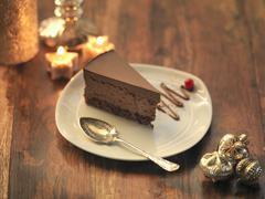 Chocolate and chestnut torte amongst festive decorations - stock photo