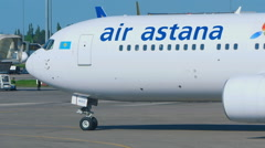 Boeing 767 Air Astana taxiing Stock Footage