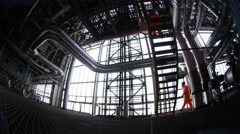 4K Distorted view of engineers at work in industrial plant - stock footage