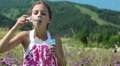 Girl blowing soap bubbles HD Footage