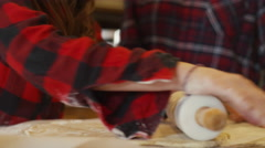 Close up of a girl rolling dough with a rolling pin Stock Footage