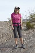 Portrait of senior female hiker on arid hill - stock photo