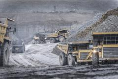 Dumper trucks in surface coal mine Stock Photos