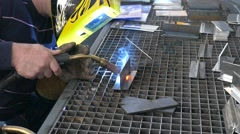 Male hand welding iron plates Stock Footage