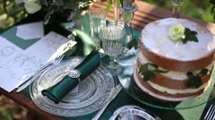 Luxury decorated wedding table with chocolate wedding cake close up. Table Stock Footage