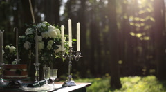 Composition of white vintage candelabrum and white roses bouquet on the wedding Stock Footage