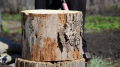 A man chopping wood with an ax a log red . chopping wood with an ax Stock Footage
