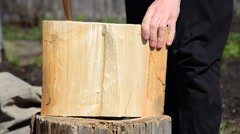 a man chopping wood with an ax log into small wood . chopping wood with an ax - stock footage