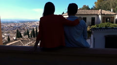 Silhouette of couple admiring cityscape view  - stock footage
