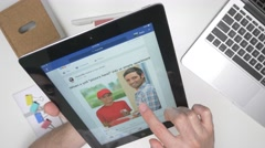 4K Top View  - Facebook app on Tablet Device Stock Footage
