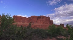 ARCHES NATIONAL PARK, desert landscape under clouds and blue sky Stock Footage